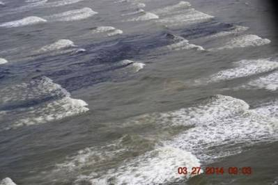 Oil washing ashore Matagorda Island: USCG photo