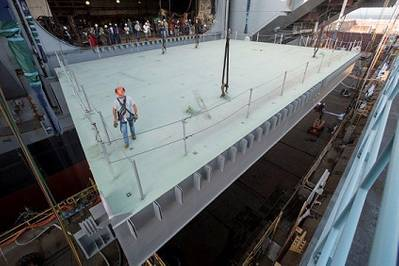 Newport News Shipbuilding recently installed the final aircraft elevator platform on the aircraft carrier Gerald R. Ford (CVN 78). The elevator is used to move aircraft from the hangar bay to the flight deck quickly and safely. Photo by Chris Oxley