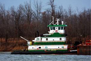 Paducah Kentucky-based photographer Jeff L. Yates took this photo on January 7, 2011 as M/V Baffin Bay was holding against the right descending bank at mile 6.5 on the Tennessee River, probably waiting for improved weather conditions on the Ohio River. Jeff reports that she was en-route from Decatur, Alabama to Houston Texas and pushing two barges at the time. Jeff L. Yates photo courtesy of Cummins Marine.