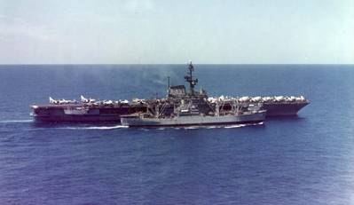 Paricutin (AE-18) rearming Coral Sea (CVA-43). U.S. Navy photo.
