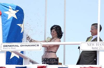 PCU New Hampshire (SSN 778) sponsor Cheryl McGuinness and General Dynamics Electric Boat President John P. Casey formally christen the fifth Virginia class submarine Saturday, June 21, 2008 at General Dynamics Electric Boat shipyard in Groton, Conn. McGuinness, a resident of Portsmouth, H.H., lost her husband, Tom, on September, 11, 2001, in the World Trade Center attacks. He was a co-pilot on American Airlines Flight 11. U.S. Navy photo by John Narewski