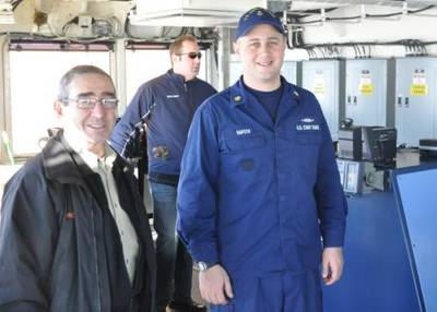 Petty Officer 1st Class Zachary Rafoth, a damage controlman aboard Coast Guard Cutter Mackinaw, gives a tour of the Mackinaw's bridge, Feb. 4, 2013. Rafoth was recently named the 2013 Coast Guard 9th District's Enlisted Person of the Year. (U.S. Coast Guard photo courtesy of Petty Officer 1st Class Zachary Rafoth)