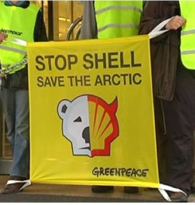 Protest banner: Image courtesy of Greenpeace