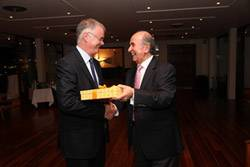 Ray Pomfret and Mathew Los, Chairman of the Greek Group, at the Yacht Club of Greece in Athens exchanging gifts.