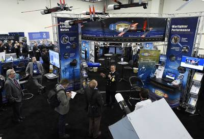 Rear Adm. Mat Winter, chief of naval research, holds a press conference at the ONR exhibit during the 2016 Sea-Air-Space Exposition. (U.S. Navy photo by John F. Williams)