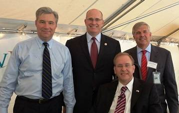 "Rep. Jim Langevin (front), Sen. Sheldon Whitehouse, Acting Maritime Administrator Paul ""Chip"" Jaenichen, and ProvPort Chief Operating Officer Bruce Waterson"