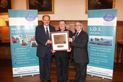 Revd Canon Ken Peters receiving his honorary masters licence from Michalis Pantazopoulos (left) and Jonathan Spremulli, general manager of LISCR's London office (right)