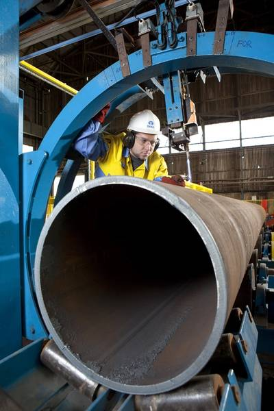 Robert Instone prepares cutting tool to produce section for offshore wind turbine foundation