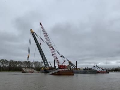 Rock barge ACL 01700 split in half and sunk after grounding near Mile Marker 99 in Berwick, La. earlier this week. Salvage operations have continued day and night. (Photo Alexandria Preston / U.S. Coast Guard)