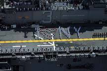 "Sailors aboard the amphibious assault ship USS Kearsarge (LHD 3) spell out ""I Love NY"" while pulling into New York City during the parade of ships for the 21st Fleet Week New York 2008. More than 4,000 Sailors, Marines, and Coast Guardsmen will participate in various community relation projects and have the opportunity to visit popular attractions in New York City. U.S. Navy photo by Mass Communication Specialist 3rd Class David Danals"