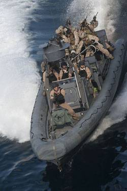 Sailors assigned to the USS New Orleans (LPD 18) operate a rigid-hull inflatable boat during a practice mission with the 11th Marine Expeditionary Unit (11th MEU) Maritime Raid Force.
