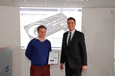 Second Officer Piers Edward Duncan Boileau-Goad (left) of Oceania Cruises went into the classroom as the 2,500th course participant at Interschalt  MET. A certificate, presented by MET head Captain Axel Schult, will remind Mr.Boileau-Goad of the special occasion. (Photo: Justin Hohmann)