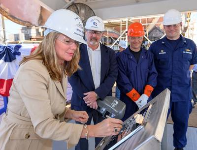 Ship sponsor Christina Calhoun Zubowicz writes her initials onto a steel plate that will be welded inside Calhoun (WMSL 759), the national security cutter named in honor of her grandfather, Charles L. Calhoun. Pictured with Zubowicz are (left to right) George Nungesser, Ingalls Shipbuilding Vice President of Program Management; Christopher Tanner, a structural welder at Ingalls; and Capt. Peter Morisseau, commanding officer, U.S. Coast Guard Project Resident Office Gulf Coast. Photo by Lance Dav