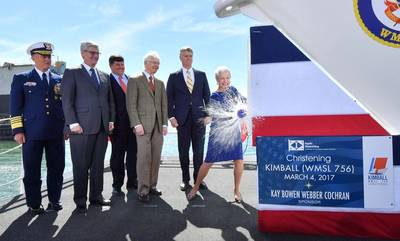 Ship's sponsor Kay Webber Cochran smashes a bottle of sparkling wine against the bow of the Ingalls-built National Security Cutter Kimball (WMSL 756). Also pictured (left to right) are U.S. Coast Guard Commandant Adm. Paul Zukunft; Mississippi Gov. Phil Bryant; Rep. Steven Palazzo, R-Miss.; Sen. Thad Cochran, R-Miss.; and Ingalls Shipbuilding President Brian Cuccias. (Photo by Lance Davis/HII)