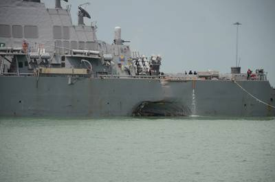 Significant visible damage to USS John S. McCain (DDG 56) following a collision with the merchant vessel Alnic MC while underway east of the Straits of Malacca and Singapore on Aug. 21. (U.S. Navy photo by Madailein Abbott)