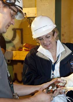 Susan Ford Bales receives a lesson in connecting instrumentation wiring during her Oct. 11 visit to Newport News Shipbuilding. (Photo: Huntington Ingalls Industries)