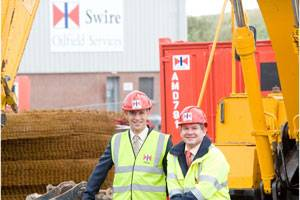 Swire Oilfield Services (left) General Manager, Rupert Bray, and Operations Manager UK, Andy Yule, at the company's expanding Fleet Refurbishment workshop in Aberdeen. (Photo Fifth Ring Integrated Corporate Communications)