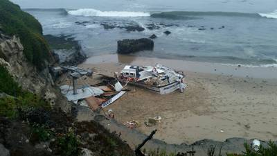 The 56-foot commercial fishing vessel, Pacific Quest, is broken and beached near Seymour Marine Discovery Center in Santa Cruz, Calif., August 13. Responders are working to remove fuel from tanks on the beach during low tide. (U.S. Coast Guard courtesy photo)