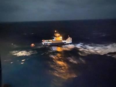 The 62-foot tugboat, Gulf Man, and a barge afloat approximately six miles northeast of Andros Island, Bahamas, January 9, 2020. A Coast Guard helicopter crew hoisted all three crewmembers and transported them to Nassau, Bahamas. (Photo: U.S. Coast Guard)