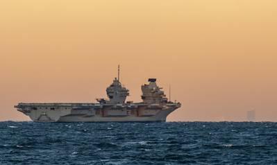 The British Royal Navy aircraft carrier HMS Queen Elizabeth (R08) steams alongside the U.S. Navy destroyer USS Michael Monsoor (DDG 1001) in 2018. (Photo: John Philip Wagner, Jr. / U.S. Navy)