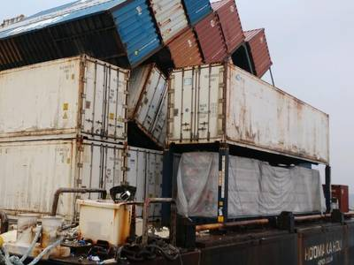 The collapsed row of containers on the barge Ho'omaka Hou in Hilo, Hawaii. (Photo: U.S. Coast Guard.)