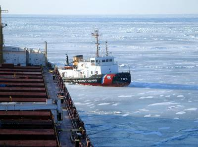 The crew of Coast Guard Cutter Neah Bay, homeported in Cleveland, works to keep the CSL Laurentien moving during an escort in eastern Lake Erie March 27, 2014. (U.S. Coast Guard photo courtesy of CSL Laurentien)