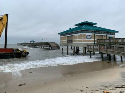 The damaged James T. Wilson fishing pier with debris on the deck of the barge is depicted in this photo taken Nov. 17, 2019. (Photo Credit: U.S. Coast Guard)