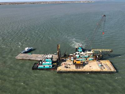 The dredge barge Everett Fisher sits aground in the Matagorda Ship Channel near Port Lavaca, Texas. (U.S. Coast Guard photo by Sector/Air Station Corpus Christi)