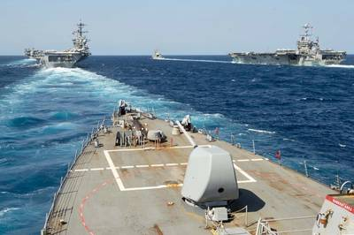 The guided-missile destroyer USS Arleigh Burke (DDG 51) transits in formation with the guided-missile destroyer USS Mason (DDG 87), the guided-missile cruiser USS Normandy (CG 60), and the aircraft car-riers USS Abraham Lincoln (CVN 72) and USS Harry S. Truman (CVN 75) during dual-carrier sustainment and qualification operations in the Atlantic. (U.S. Navy photo by Mass Communication Specialist 2nd Class Justin Yarborough/Released)