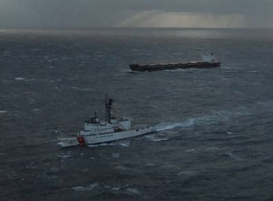 The Kodiak-based Coast Guard Cutter Alex Haley escorts the 738-foot cargo vessel Golden Seas while under tow to Dutch Harbor by the tug Tor Viking II Dec. 5, 2010, 50 miles west southwest of Dutch Harbor in the Pacific Ocean. The Golden Seas requested a tow after suffering a turbo-charge failure Dec. 3 limiting power and steerage. U.S. Coast Guard photo by Petty Officer 1st Class Sara Francis.