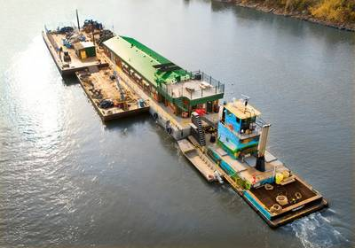 "The M/V River Cleanup II pushes Living Land & Waters' floating classroom ""Teamwork"" en route to New Orleans."