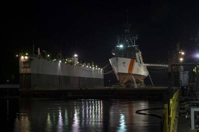 The National Security Cutter Munro (WMSL 755) sits in the floating dry dock at Ingalls Shipbuilding prior to its launch on Saturday. (Photo by Lance Davis/HII)