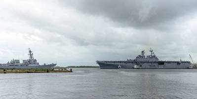 The Navy's newest amphibious assault ship, USS Tripoli (LHA 7), departed from Ingalls Shipbuilding division today, sailing to its homeport in San Diego. Tripoli enters the Pascagoula River channel passing guided missile destroyer Delbert D. Black (DDG 119), which has been delivered to the Navy by Ingalls, and will sail away later this year. (Photo by Lance Davis/HII)