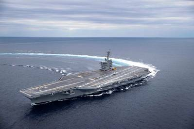 The Nimitz-class aircraft carrier USS Abraham Lincoln (CVN 72) conducts high-speed turn drills in the Atlantic Ocean during sea trials. Photo: United States Navy
