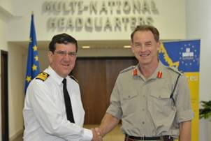 The outgoing Operation Commander Rear Admiral Peter Hudson CBE (left) hands over to the new Operation Commander Major General Buster Howes OBE. (Photo courtesy EU NAVFOR)