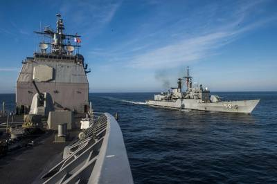 The Peruvian frigate BAP Quiñones (FM 58) is underway alongside the Ticonderoga-class guided-missile cruiser USS Lake Champlain (CG 57) during a leapfrog exercise. Lake Champlain is participating in Silent Forces Exercise 2018 with the Peruvian and Colombian navies. (U.S. Navy photo by Mass Communication Specialist 1st Class Nathan Carpenter/)