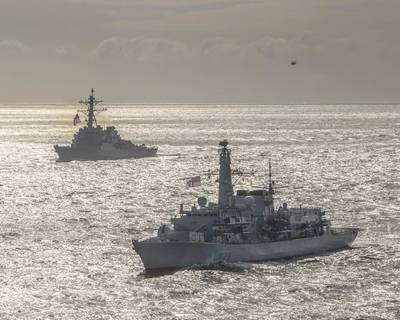 The Royal Navy Type-23 Duke-class frigate HMS Kent (F78), front, and the Arleigh Burke-class guided-missile destroyer USS Donald Cook (DDG 75) conduct joint operations to ensure maritime security in the Arctic Ocean, May 5, 2020. (U.S. Navy photo courtesy of the Royal Navy by Royal Navy Photographer Dan Rosenbaum)