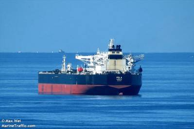 The ship with the mine on the hull has been identified as the Liberia-flagged Pola, and is owned by Dynacom Tankers. Image Credit: Max Wei