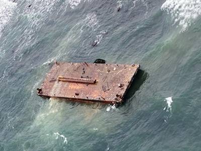 The U.S. Coast Guard rescued three mariners from a disabled 108-foot barge off Point Judith, R.I., November 25, 2020. (Photo: U.S. Coast Guard)