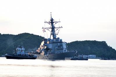 The U.S. Navy Arleigh Burke-class guided-missile destroyer USS Fitzgerald (DDG 62) returns to Fleet Activities Yokosuka following a collision with a merchant vessel while operating southwest of Yokosuka, Japan, June 17, 2017. (U.S. Navy photo by Peter Burghart)