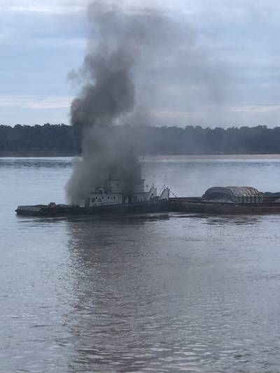 The vessel Jacob Kyle Rusthoven caught fire on the lower Mississippi River near West Helena, Ark., on September 12. (U.S. Coast Guard photo by Brandon Giles)