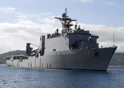 The Whidbey Island-class dock landing ship USS Ashland (LSD 48) arrives at the Marathi NATO Pier Facility for a routine port visit. Ashland is homeported at Navy Amphibious Base Little Creek, Va. and is deployed supporting maritime security operations. U.S. Navy photo by Paul Farley