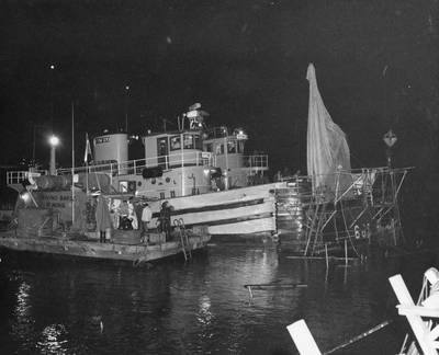 U.S. Navy tugs and diving barge alongside USS Guitarro (SSN-665) May 15, 1969 (U.S. Navy photo)