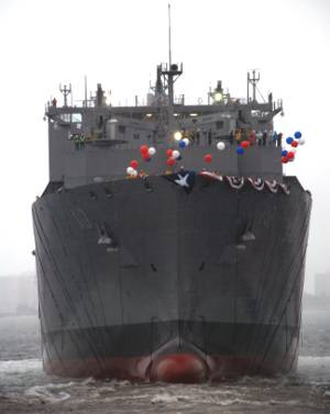 USNS Charles Drew, the 10th ship in the Navy's class of dry cargo/ammunition ships, slides into the water following its christening Feb. 27, at the General Dynamics NASSCO shipyard in San Diego. (Photo courtesy U.S. Navy)