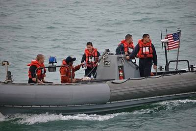 USS Spruance rescuers & survivor: USN Photo