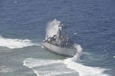 Waves Break Over USS Guardian: Photo credit USN