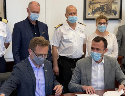 Windstar Cruises' President Chris Prelog (on left) finishes signing handover documents for Star Legend at the Fincantieri shipyard in Palermo, Italy. (Photo: Windstar Cruises)