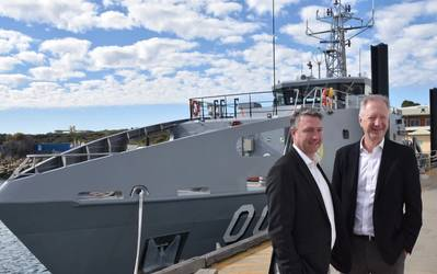 Patrick Gregg (Left) and David Singleton standing in front of a Guardian-class patrol Boat at Austal's Australian shipyard in Henderson, Western Australia. (Photo: Austal)