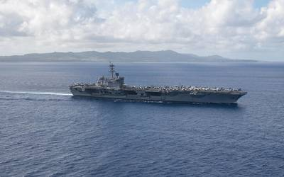 The aircraft carrier USS Theodore Roosevelt (CVN 71) returns to operations in the Philippine Sea on May 21 following an extended visit to Guam in the midst of the COVID-19 global pandemic. (U.S. Navy photo by Kaylianna Genier)