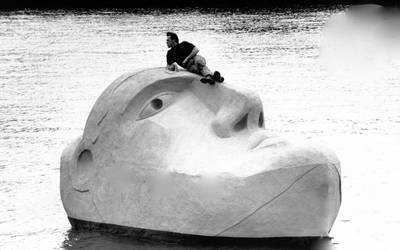 The Floating Head, a sculpture created by artist Richard Groom, as the centrepiece for Glasgow's 1988 Garden Festival, has been lovingly restored over the past six months, and is now on public display at Canting Basin at Govan Docks, adjacent to Glasgow Science Centre, for the next four weeks. Pictured is Richard Groom on Floating Head on the Clyde. Photo courtesy AMS